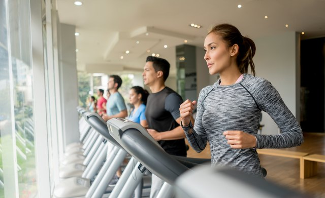 Group of people exercising at the gym on the treadmills