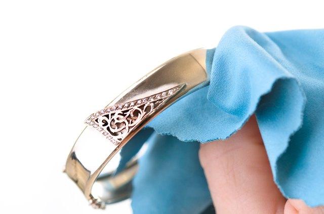 Polishing jewelry with a cloth