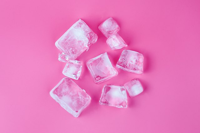 Directly Above Shot Of Ice Cubes Over Pink Background