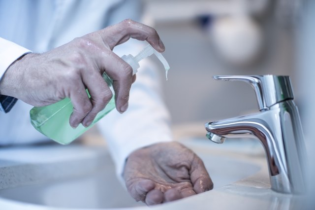 Doctor washing hands with soap