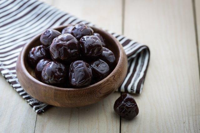 Dried plums on wood floor