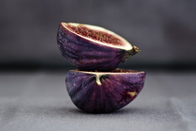Two halves of a fig, one on top of the other