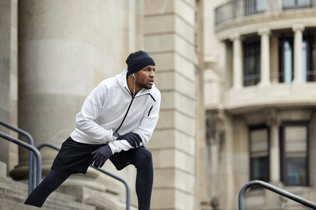 Determined man exercising on steps in city