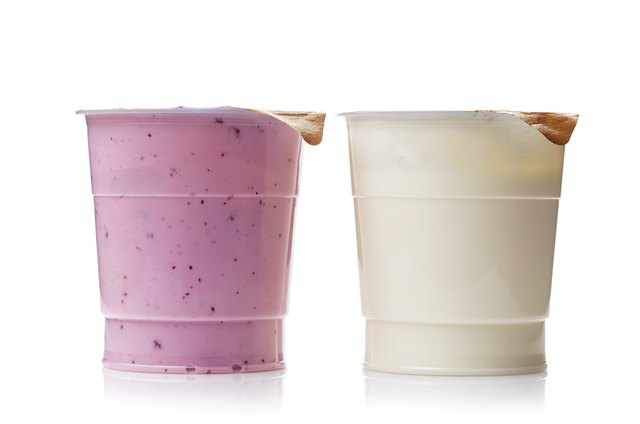 two plastic yogurt pots