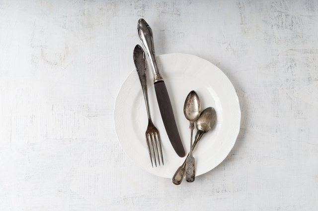 Silver cutlery on plate