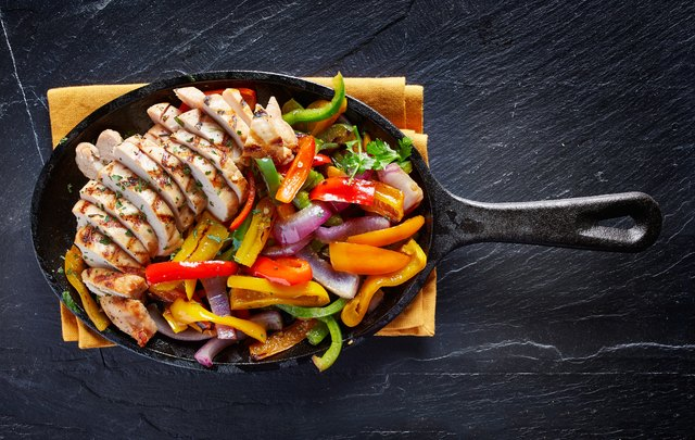mexican grilled chicken fajitas in iron skille