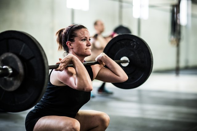 Woman doing front squats in a CrossFit workout
