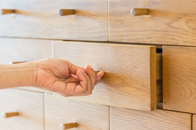 Cropped Hand Of Person Opening Drawer