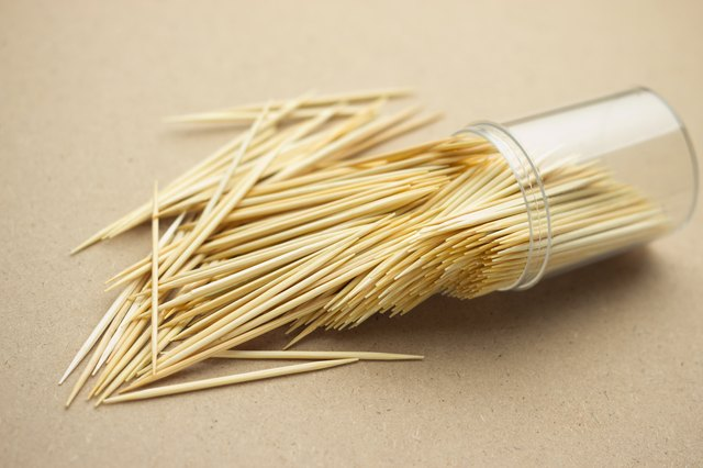 High Angle View Of Toothpick In Container On Table