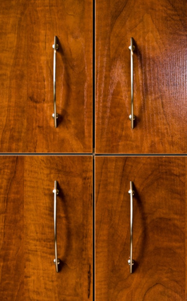 How To Paint Over Veneer Cabinets Ehow