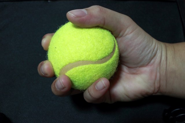 Close-Up Of Human Hand Holding Tennis Ball