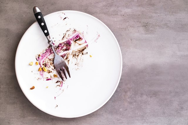 White empty plate with crumbs after fasting