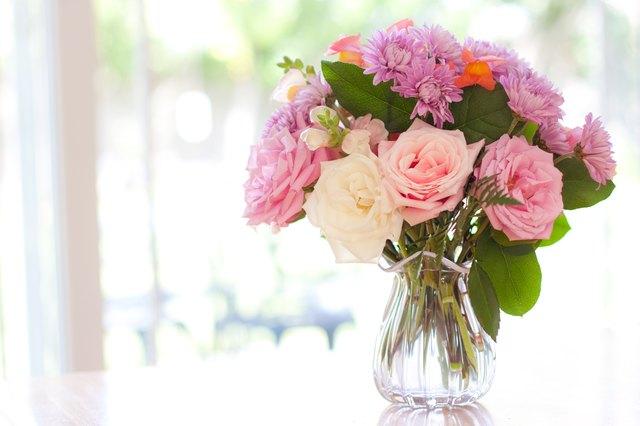 Bouquet of flowers on table near window