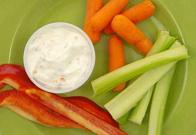 Close view of celery peppers carrots ranch dressing