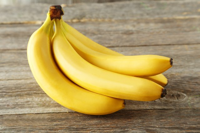 Bunch of bananas on grey wooden background