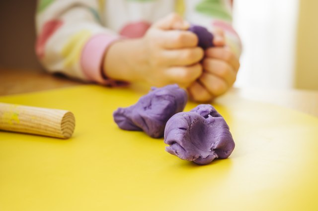 Child's hands kneading modelling clay