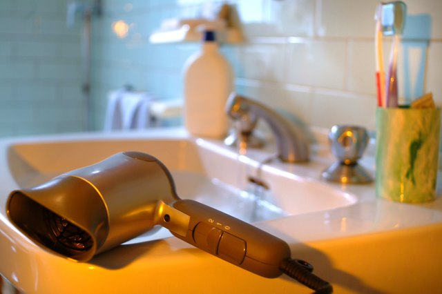 Close-Up Of Hair Dryer On Sink