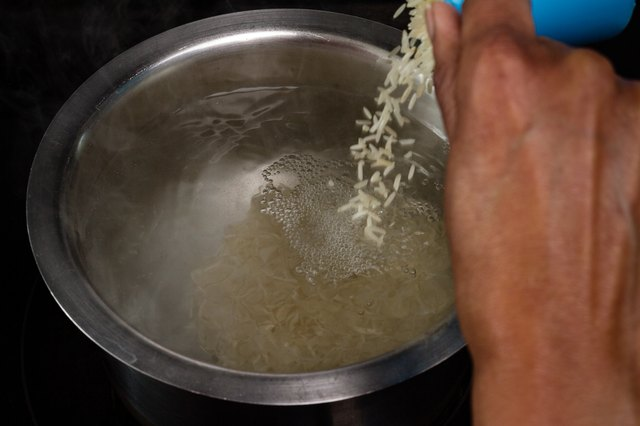 Pouring rice into hot water