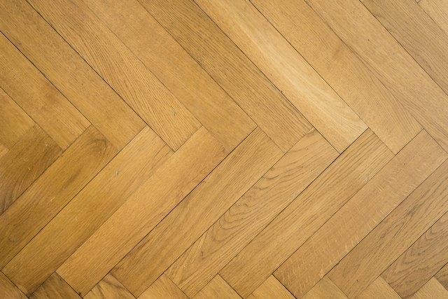 herringbone pattern on old oak parquet hardwood floor
