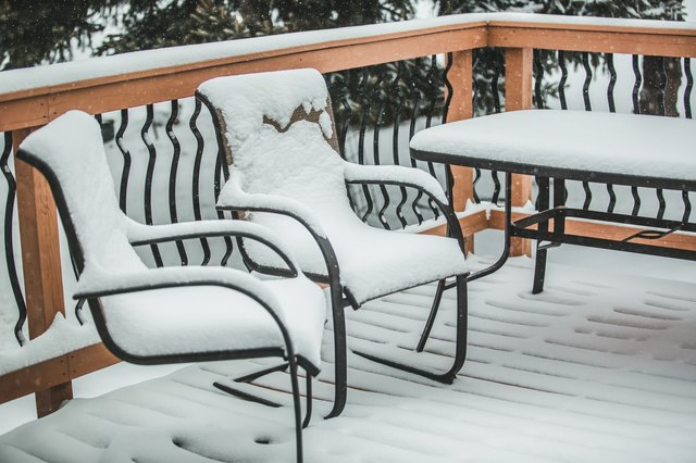 Patio Chairs and Table covered in snow