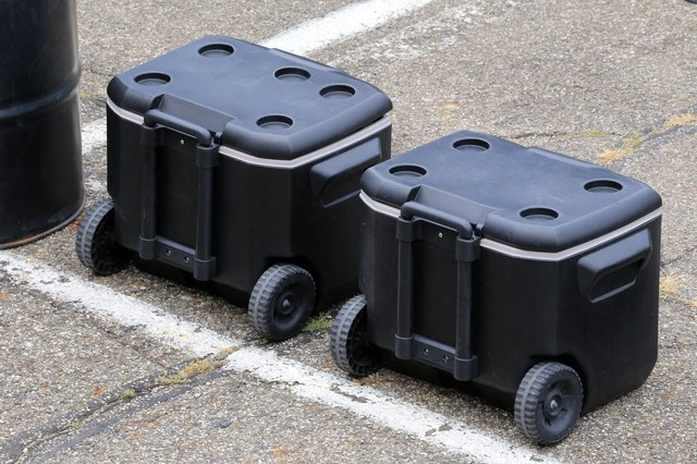Two large coolers on wheels