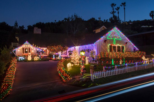 House with abundant exterior Christmas lights