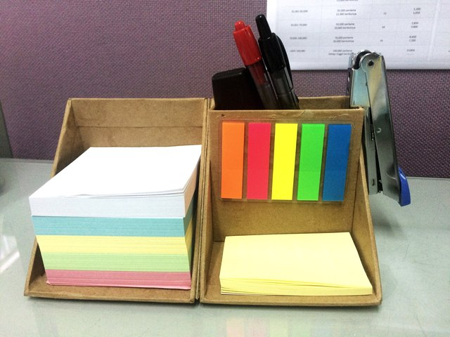 Close-Up Of Desk Organizer With Colorful Adhesive Notes At Office