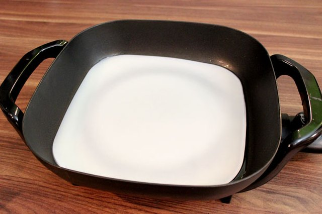 Melt beeswax in an electric skillet