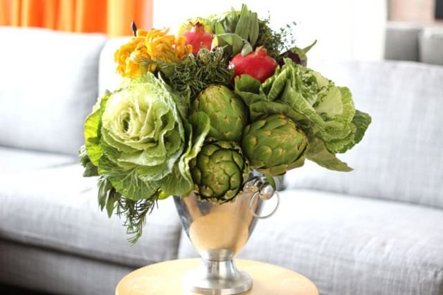 Seasonal fruits and vegetables serve as elegant and edible floral arrangements.