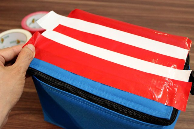 Layer red and white duck tape to make stripes