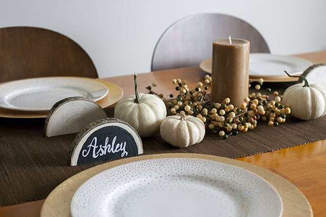 Log-slice place cards create a forest-like dinner setting.