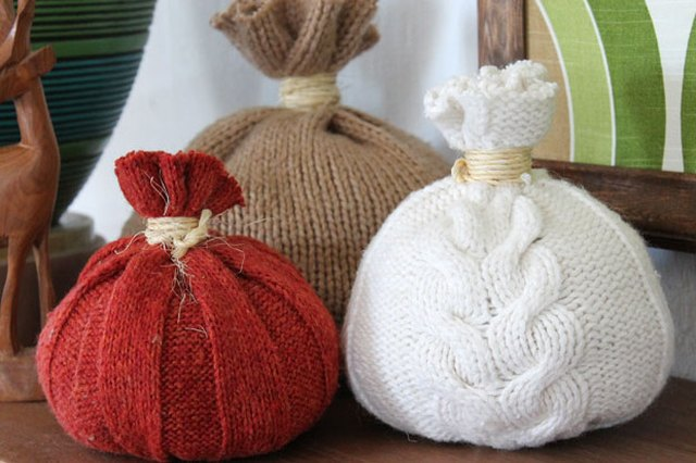 Create a cozy environment this fall with sweater pumpkins.