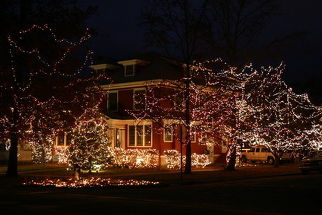 Candles. Outdoor Christmas light ... - The History Of Christmas Lights On Houses EHow