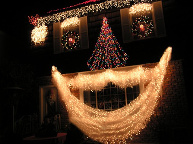 Hook your Christmas lights up in series or in parallel. - Series Vs. Parallel Circuit For Christmas Lights EHow