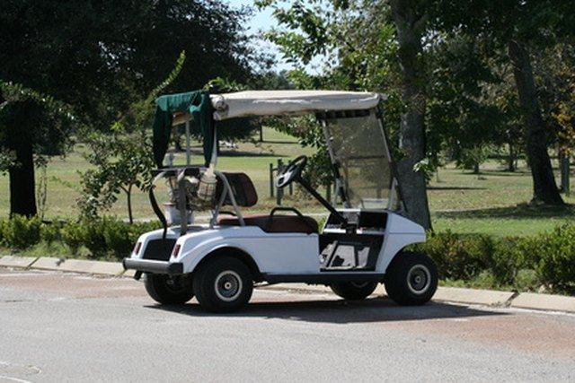 How to Power Christmas Lights on a Golf Cart | eHow Minnie Golf Cart Decorated on custom concepts carts, mardi gras shopping carts, decorated doors, decorated shopping carts, old people extreme carts,