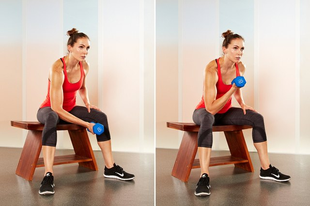 Woman performing concentration biceps curls.