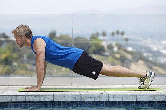 Man doing plank pose exercise for better sex