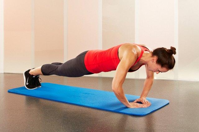 Woman performing diamond push-ups.