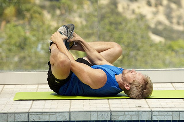 Man doing reclined butterfly pose for better sex