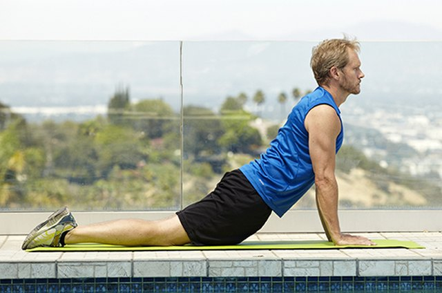 Man doing Upward Facing Dog yoga pose for better sex