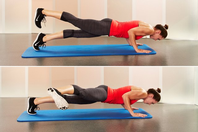 Woman doing hard-core plank as part of her arm workout