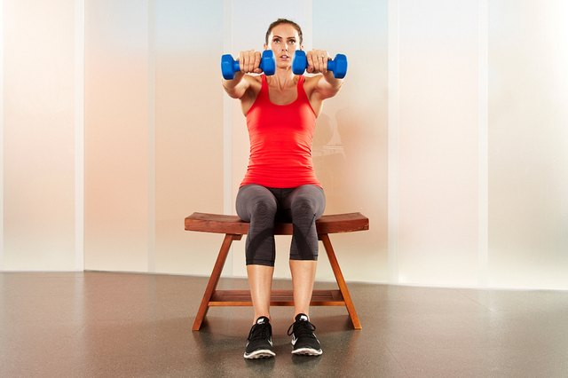Woman performing dumbbell arm circles.