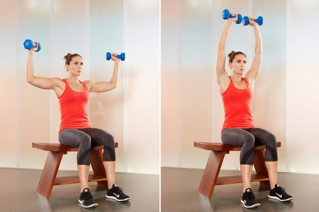 Woman performing shoulder press exercise.