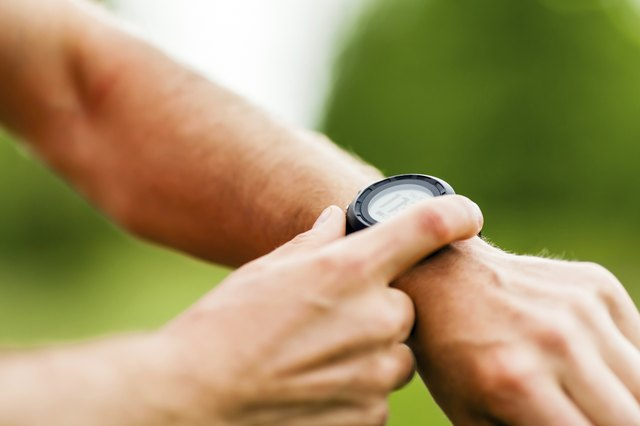 Trail runner looking at sport watch