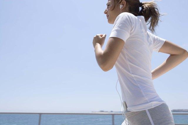 Teenage girl running by ocean