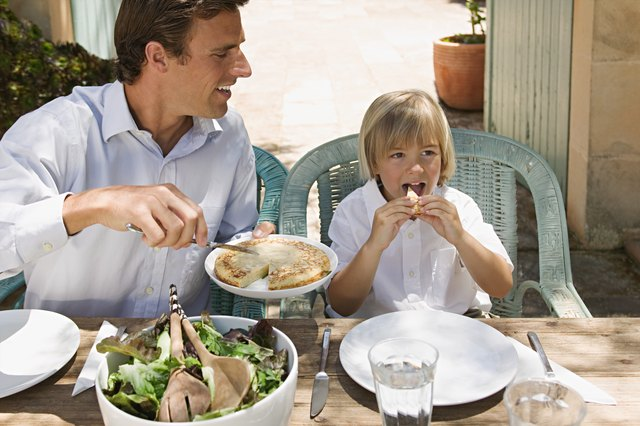Father and son dining al fresco