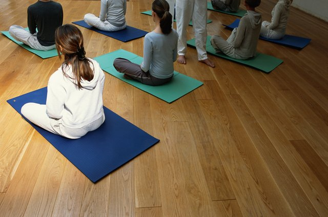Women with cross legged in yoga class