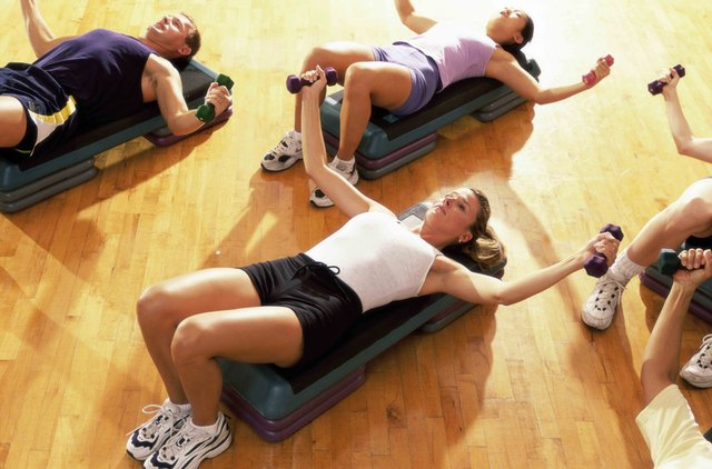 High angle view of five people exercising in a step aerobics class
