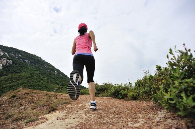 runner running on seaside mountain trail
