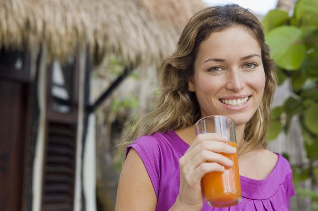 Woman with glass of juice outdoors